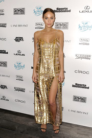 Hannah Davis slipped into a lingerie-inspired gold plaid evening dress for Sports Illustrated's A Night at Sea VIP boat cruise.