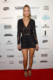 Hannah Davis went for relaxed glamour in a black sequin romper during the Sports Illustrated Swim BBQ.