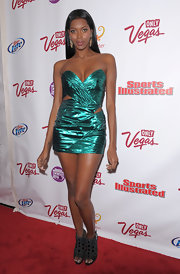 Jessica White toughened her metallic emerald mini with a pair of bejeweled black peep-toe booties.