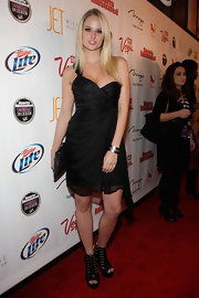 A pair of chunky black cutout boots added a dose of edginess to Genevieve Morton's girly look.
