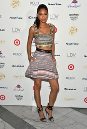 Chanel Iman donned a blingy crop-top by Fausto Puglisi for the SI Swimsuit South Beach Soiree.