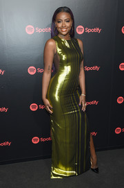 Justine Skye flaunted her figure in a slinky striped chartreuse gown during Spotify's Best New Artist party.