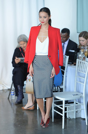 Jamie Chung looked perfectly styled in a red Reese + Riley blazer layered over a white camisole at the Marchesa fashion show.