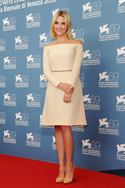Ashley Benson looked simply elegant in her off the shoulder ivory dress and nude pumps.