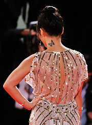 Vanessa's updo showed off her pretty butterfly tattoo on the back of her neck.