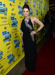 Ashley Benson opted for a dark and edgy look with this long black dress with lace detailing.