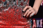 A snake ring delicately wrapped around the pinky finger of Vanessa Hudgens at the 'Spring Breakers' premiere in Madrid.