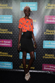 Alek Wek finished off her eclectic ensemble with a pair of frilly peep-toe pumps.