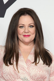 Melissa McCarthy opted for a simple center-parted hairstyle when she attended the 'Spy' New York premiere.
