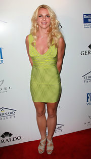 Britney Spears complemented her lime bandage dress with bone leather platforms with crisscrossing straps.