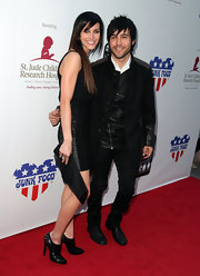 Ashlee posed with her happy hubby sporting studded leather ankle booties.