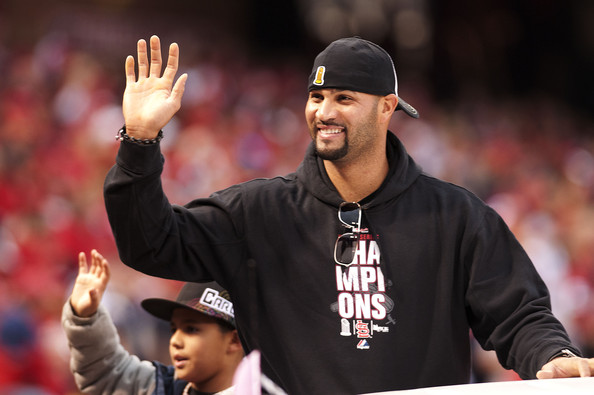 Albert Pujols accessorized with silver rimmed aviator sunglasses at the St Louis Cardinals victory parade.