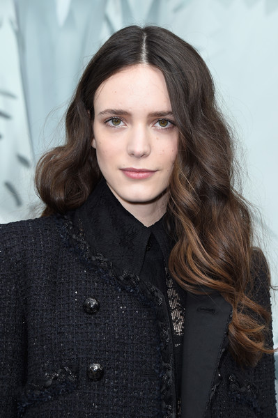 Stacy Martin Long Wavy Cut [s/,show,hair,face,hairstyle,eyebrow,lip,long hair,beauty,brown hair,layered hair,fashion,stacy martin,front row,part,paris,france,chanel,paris fashion week,haute couture spring]