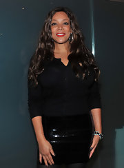 Wendy Williams paired her black blouse with a sequined skirt.