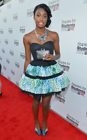 Coco Jones paired off her stunning minidress with a pair of blue and silver satin peep-toe heels as she attended Staples' School Supply Drive.