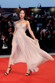 Aimee Song attended the Venice Film Festival screening of 'A Star is Born' wearing a floaty one-shoulder dress by Armani.