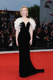 Cate Blanchett looked like royalty (as always) in a black Armani Prive velvet gown with white feather capelet detailing at the Venice Film Festival screening of 'A Star is Born.'