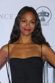 For her beauty look, Zoe Saldana paired an exotic cat eye with a red lip.