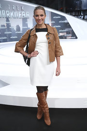 Kerstin Linnartz rocked a white frock with a leather jacket and leather boots.