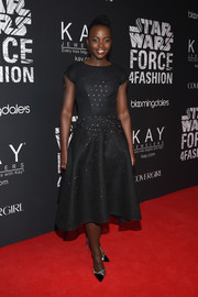 Lupita Nyong'o stunned in a black ZAC by Zac Posen dress at the Star Wars 'Force 4 Fashion' Event.