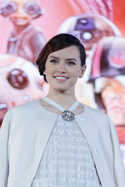 Daisy Ridley donned a retro updo with side-parted bangs for a polished look at the 'Star Wars: The Force Awakens' fan event in Japan.