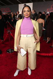 Tessa Thompson completed her white accessories with a Solace London leather clutch.
