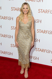 Joanne Froggatt looked radiant at the UK premiere of 'Starfish' in a form-fitting Ermanno Scervino dress rendered entirely in metallic threadwork.
