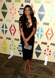 For a bit of graphic appeal to her LBD, Taraji P. Henson accessorized with a silver and black striped clutch by Edie Parker.