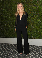 Rosie Huntington-Whiteley added a touch of '70s chic to her look with a pair of flared black pants.