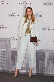 Marina Jamieson was casual yet chic in a white denim jacket layered over a silk blouse during the Coach boutique opening in Madrid.