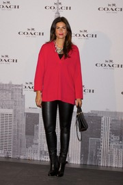 Nuria Roca went to the Coach boutique opening in Madrid wearing a hot-pink tunic.
