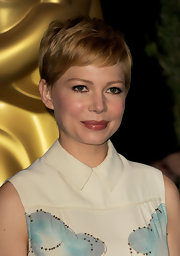 Michelle Williams wore her shiny hair in a cute razored pixie while attending the 84th Academy Awards nominations lunch.