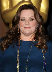 Melissa McCarthy wore her hair in long spiral curls at the 84th Academy Awards nominations lunch.