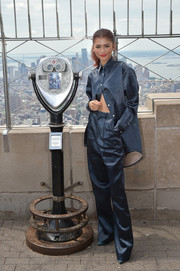 Zendaya Coleman went masculine-chic in an oversized button-down by Peter Do while visiting the Empire State Building with the stars of 'Spider-Man: Far from Home.'