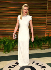 Naomi Watts was all about minimalist elegance in a white cap-sleeve evening dress by Calvin Klein at the Vanity Fair Oscar party.