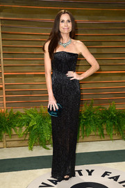 Minnie Driver looked super slim in her strapless black column dress at the Vanity Fair Oscar party.