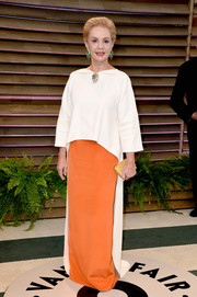 Carolina Herrera looked regal in her white and orange evening dress during the Vanity Fair Oscar party.