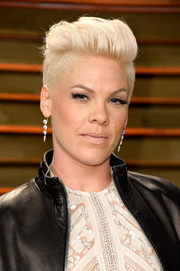 Pink stuck to her trademark platinum-blond fauxhawk when she attended the Vanity Fair Oscar party.