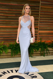 Rosie Huntington-Whiteley complemented her gown with a pearl-studded clutch by Aldo.