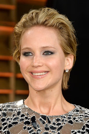 Jennifer Lawrence sported a messy short 'do (but looked gorgeous anyway) at the Vanity Fair Oscar party.