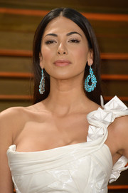 Moran Atias accessorized with a pair of dangling turquoise earrings by Lorraine Schwartz for some color and flair.