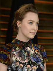 Saoirse Ronan fixed her hair into a classic bun with teased bangs for the Vanity Fair Oscar party.