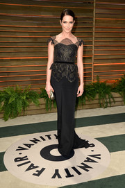 Katie Aselton was all about classic elegance in a black evening dress with a lace bodice during the Vanity Fair Oscar party.