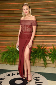 Malin Akerman oozed sexy sophistication at the Vanity Fair Oscar party in a burgundy J. Mendel off-the-shoulder gown with a thigh-high slit.