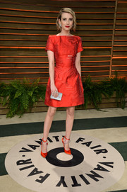Emma Roberts went for classic elegance in a red Fendi cocktail dress during the Vanity Fair Oscar party.