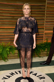 Diane Kruger showed plenty of skin in a sheer black lace dress by Valentino during the Vanity Fair Oscar party.