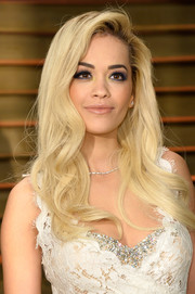 Rita Ora complemented her lace dress with a long wavy 'do for a totally feminine vibe at the Vanity Fair Oscar party.