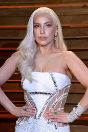 Lady Gaga got all jeweled up with a pair of gemstone cuff bracelets for the Vanity Fair Oscar party.