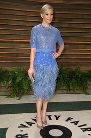 Elizabeth Banks teamed her sequined top with a feathered periwinkle pencil skirt, also by Jenny Packham, for a totally frilly-chic look.