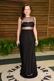 Elisabeth Moss rocked the sheer trend with this black number by Houghton during the Vanity Fair Oscar party.